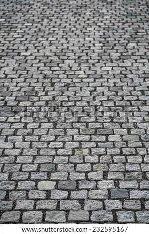 Dark gray granite cobble stone pavement, the base of the modern street architecture - stock photo