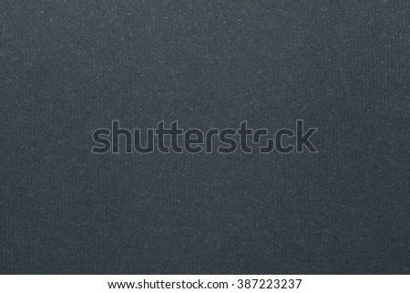 Dark grey cardboard texture. Grey background. - stock photo