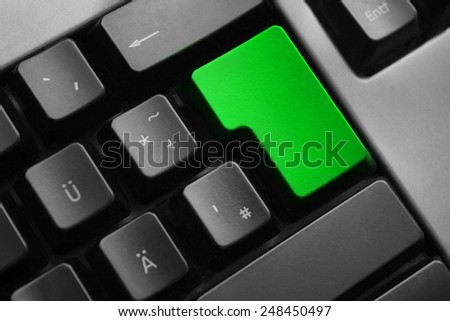 dark grey keyboard empty green enter button - stock photo