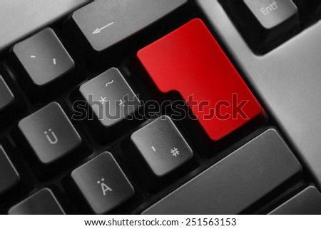 dark grey keyboard empty red enter button - stock photo