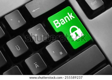dark grey keyboard green button bank security - stock photo
