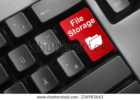 dark grey keyboard red button file storage - stock photo