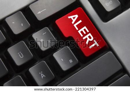 dark grey keyboard red enter button alert - stock photo