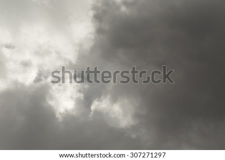 Dark grey stormy clouds. Nature background - stock photo