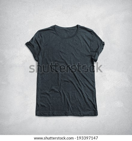 Dark grey t-shirt on concrete background - stock photo