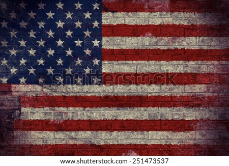 Dark Grunge American Flag on an old Brick Wall  - stock photo