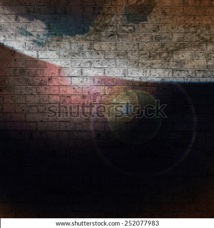 Dark Grunge image of Sunrise over Earth painted on an old Brick Wall. (Image of earth is originally from a public domain image from NASA) - stock photo