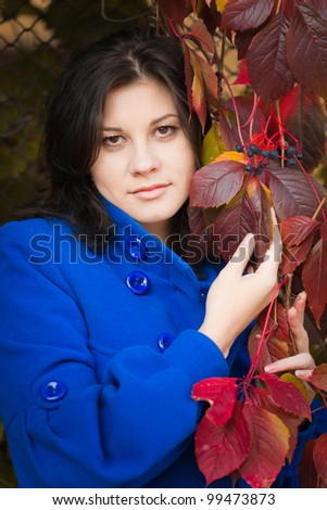 Dark-haired girl in autumn park, closeup portrait, European, White, Caucasian - stock photo