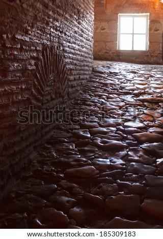 dark hallway with polished pebbles on the floor passageway inside Hagia Sophia Basilica, Istanbu Turkey - stock photo