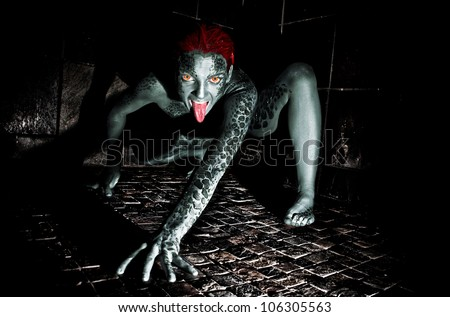 Dark Horror Scene of a Scaly Demon Crawling in the Night - stock photo