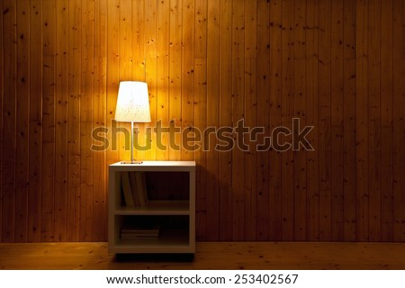 dark interior of room, lamp light in the night - stock photo