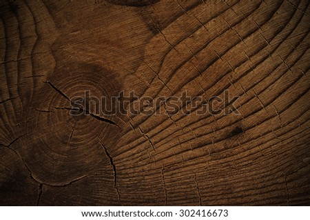 Dark knotted wood background faded - stock photo