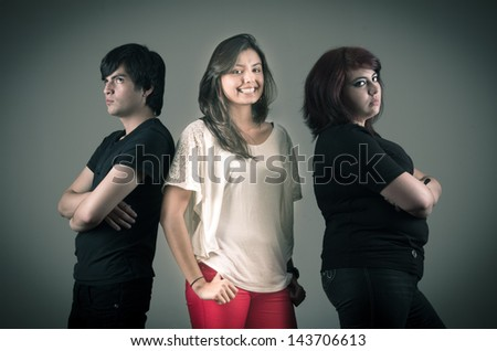 dark metal couple with happy colorful girl in the middle - stock photo