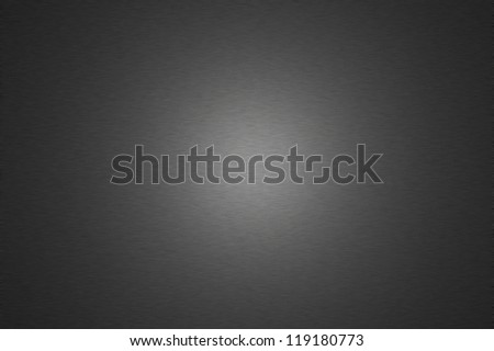 Dark metal surface with halo lighting for use as a background design element - stock photo