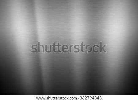 Dark metal texture neutral background with brushed chrome surface - stock photo