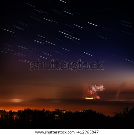 dark night epic scene with stars over the city hidden in a fog, with a fireworks - stock photo