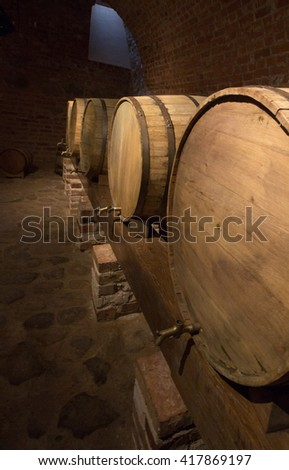 Dark old vintage wine cellar - stock photo