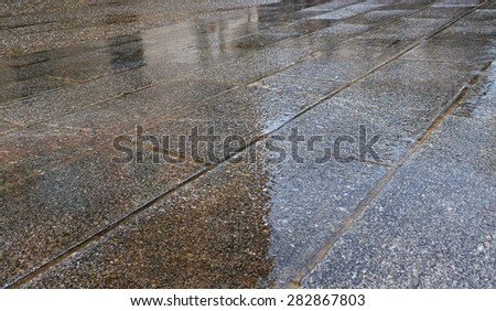 Dark pavement in rain time. - stock photo