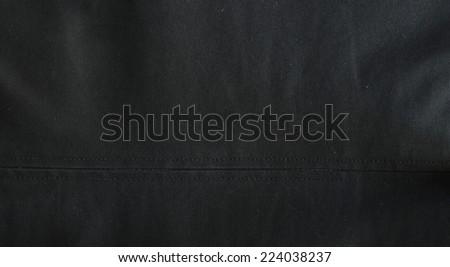 Dark polyester texture wit seam. Cotton - stock photo