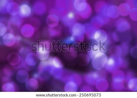dark purple bokeh background. abstract blurred lights - stock photo