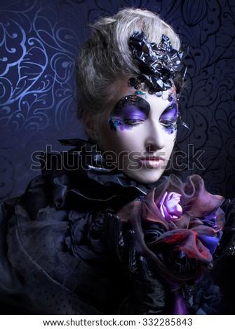 Dark queen. Young woman in creative halloween image. - stock photo