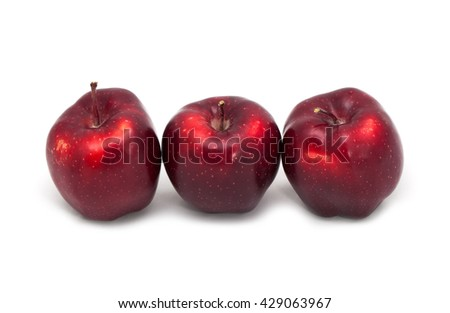 Dark red apples on a white background - stock photo