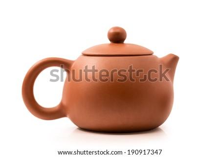 dark-red enameled pottery, teapot - stock photo
