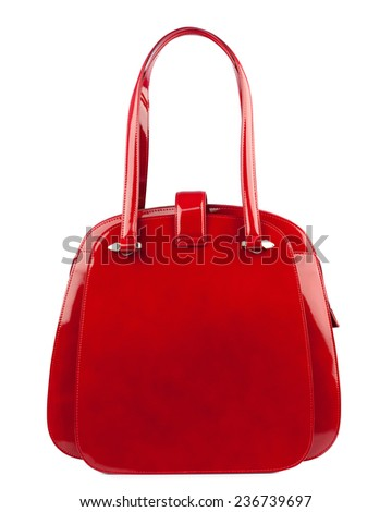 Dark red glossy female handbag isolated on white background. - stock photo