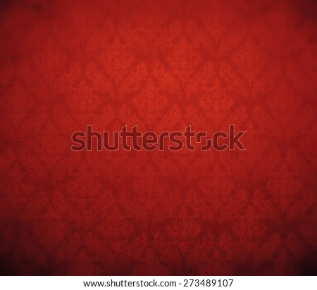 dark red wallpaper; baroque style. - stock photo