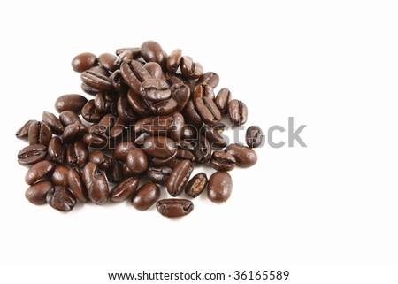 Dark roasted coffee beans isolated - stock photo