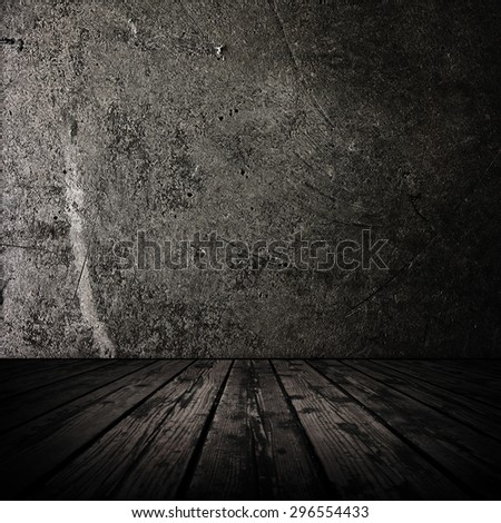 Dark room with stone wall and grungy old wooden floor. - stock photo