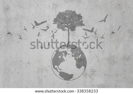 dark shadow of growing tree plant on earth sphere map graphic around with flying birds, on light gray concrete background. ecology concept - stock photo