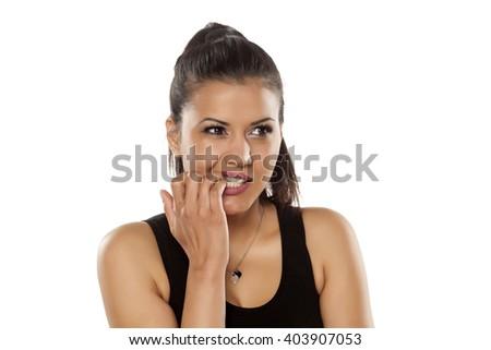 dark skinned beautiful young women nibbling her nails - stock photo