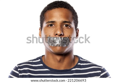 dark-skinned young man with adhesive tape over his mouth - stock photo