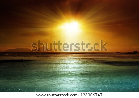 dark sky on the beach of la Digue island, Seychelles - stock photo