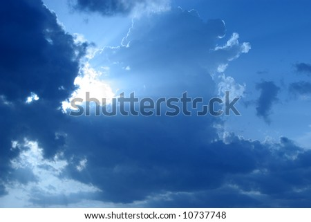dark sky with sun ray coming through the cloud - stock photo
