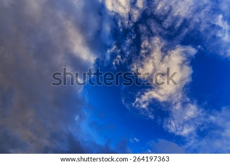 Dark storm clouds on evening sky - stock photo