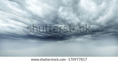 Dark storm clouds sky. Copy space below - stock photo