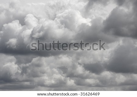 Dark stormclouds in a sky - stock photo