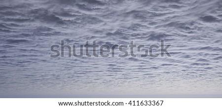 Dark thunder storm or rain clouds in the sky before rain - stock photo