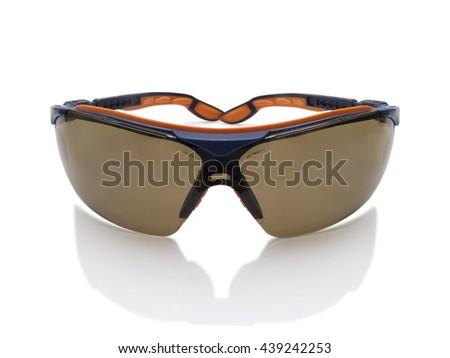 Dark toned safety glasses goggle isolated on white background - stock photo