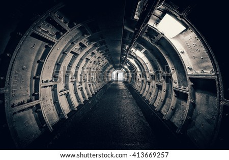 Dark tunnel with interesting structures - stock photo