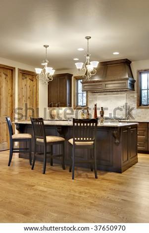 Dark Wood Kitchen with Granite Counters - stock photo