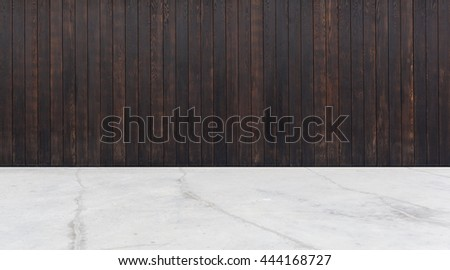 dark wood wall and concrete floor - stock photo
