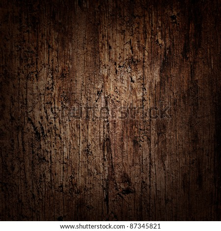 Dark wooden background with moody spot lighting - stock photo
