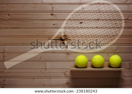 Darkened wall with sports equipment other than a place where was hanging a tennis racket. - stock photo