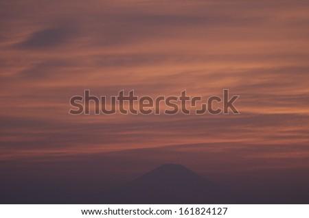 Darkening sky filled with orange clouds. - stock photo