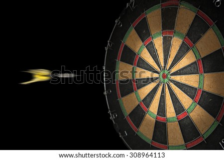 Dart and dartboard on a black background - stock photo