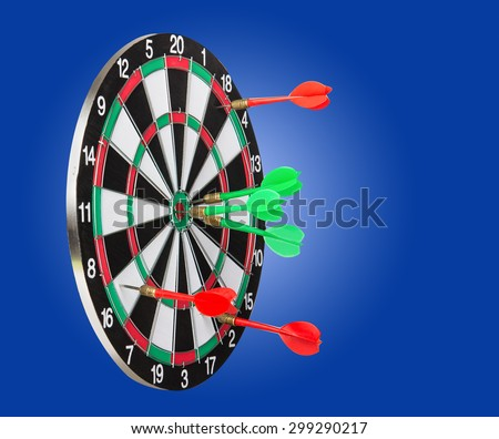 Dart board with the winner and the loser darts - stock photo