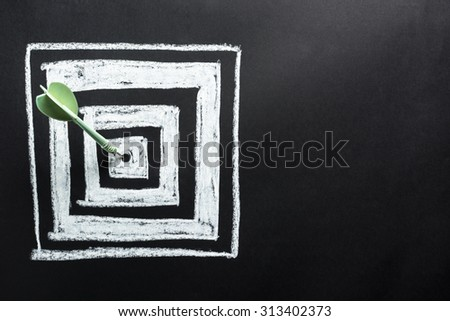 Dart hit the center of square dartboard - stock photo